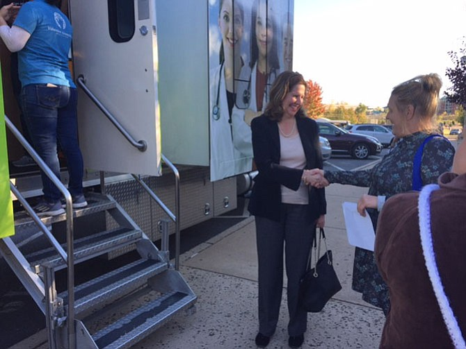 "Mayor Allison Silberberg greeted Olenia ""Kay"" Haley, who used the opportunity to learn about Obamacare and sign up; she got blood work done and tested her glucose and cholesterol levels."