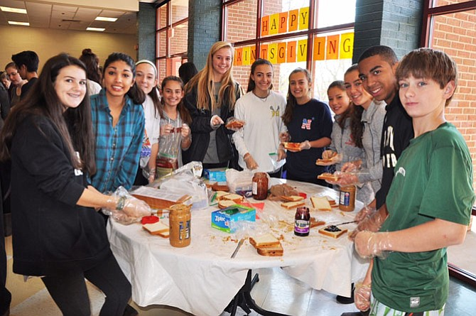 On the day before Thanksgiving 2015, students at St. Stephen's and St. Agnes School make sandwiches for the homeless.