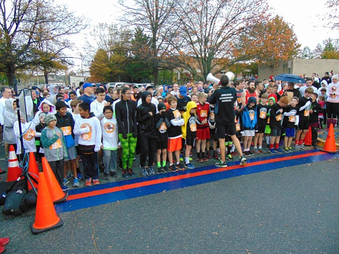 Runners at the start of The Herndon Turkey Trot 5K race at the Herndon Community Center on Saturday, Nov. 19, 2016.