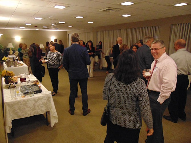 Guests mingle during the Cocktails for a Crowd fundraiser sponsored by the New Dominion Women's Club of McLean on Thursday, Nov. 17, 2016, at the Party Room in the McLean House in McLean.