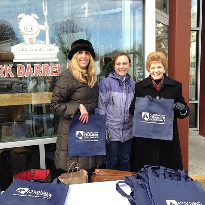 Councilwoman Del Pepper, right,  joins Shari Simmans and Maria Ciarrocchi of the Chamber of Commerce at last year's kick off to Small Business Saturday. The Chamber will again be handing out goodie bags with surprise gifts at Market Square from 9 a.m.-noon and in front of Pork Barrel BBQ from 12:15-1:15 p.m. on Nov. 26.