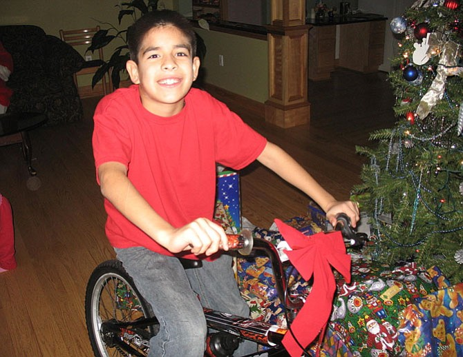 This boy received a bike from an Our Daily Bread donor in a previous year.