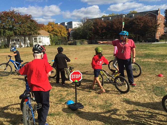 Tracy Tiernan guides Mount Vernon Community School students along a bicycle course.