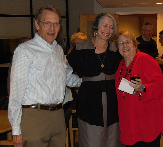 Anna Schalk, center, enjoyed speaking with two fellow Montebello residents, Mitch Levy, left, and Regina Ryder, at a reception celebrating Schalk's portraits of friends.