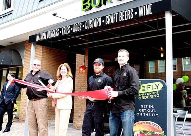 Alexandria Mayor Allison Silberberg and BurgerFi Alexandria owners (from left) Dave Landry, Chris Landry and Tim Kelly at the ribbon cutting for the restaurant's grand opening.