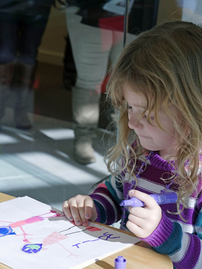 Molly Welch and three other volunteers are making Thanksgiving cards to accompany each dinner. Molly says her picture is for another 4-year-old girl who doesn't have money for a Thanksgiving dinner.