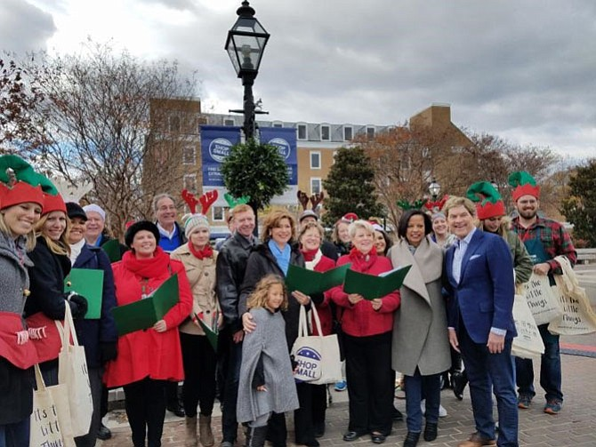 U.S. Small Business Administrator Maria Contreras-Sweet, center, along with Chamber of Commerce CEO Joe Haggerty, Visit Alexandria president Patricia Washington and Small Business Development Center executive director Bill Reagan join the Alexandria Singers for some caroling at Market Square Nov. 26 as part of Small Business Saturday.
