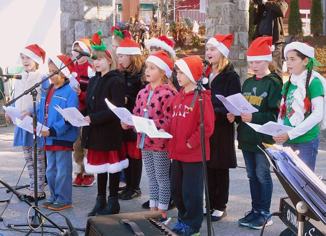 The Fairfax Choral Society Lyric Choir sings Christmas carols last December at Old Town Square.