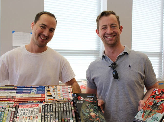 Jacob Pereira and Michael Peterson display some of the manga and comic books available during the sale. The sale will also have a large sci-fi, WWI, II and Civil War Section and fiction literature.