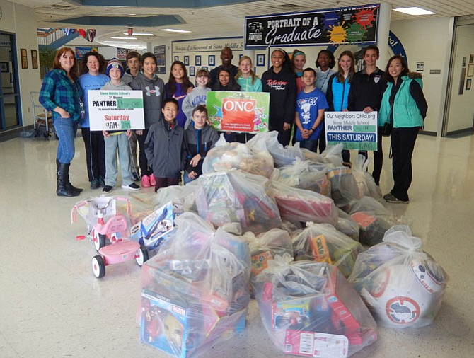 Last Saturday, Dec. 3, students in Stone Middle School's National Junior Honor Society held a Panther Drop-Off gift collection for Our Neighbor's Child. Community members brought donations of brand-new toys, books, games and clothing to the school, and the students packaged it all up and loaded it in a truck for transport to ONC's warehouse.