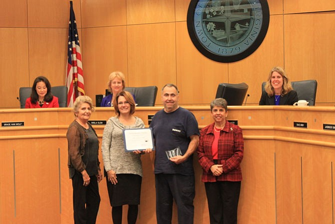 During a Herndon Town Council meeting on Nov. 29, brothers Peter and James Stalcup of Mississippi Drive in Herndon were recognized by their neighbors and the town of Herndon as recipients of the Good Neighbor Award.