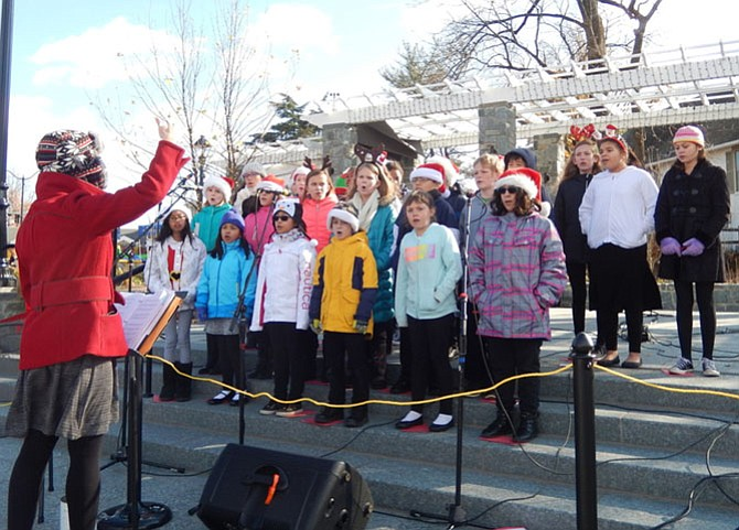 Students from Daniels Run Elementary sing Christmas carols in Old Town Square in 45-degree weather.