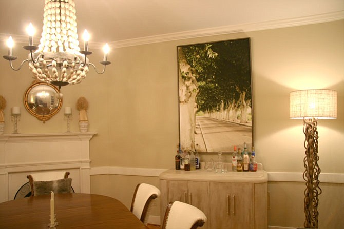 Shades of green foliage found in a painting that hung in a client's dining room was the creative inspiration of interior designer Anne M. Walker.