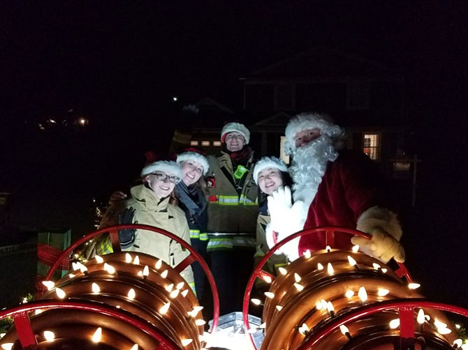 Santa and his elves prepare for the night ride through Vienna on Dec. 10, the second Santa Run of the day. The Santa Run is an annual tradition run by the Vienna Volunteer Fire Department; volunteers brave the frigid temperatures to ensure Vienna children meet Santa in-person.