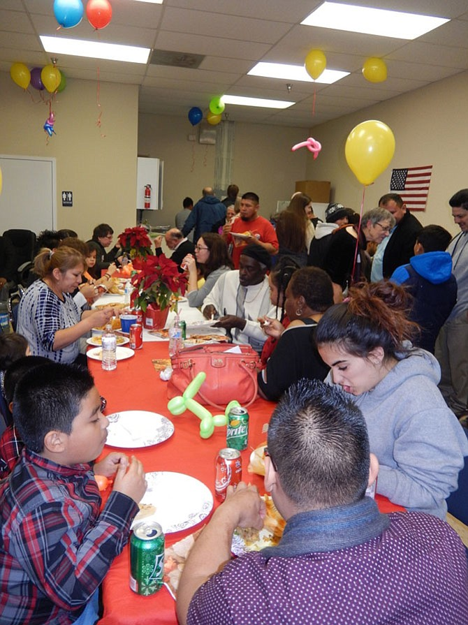 Attendees enjoy the anniversary meal together.