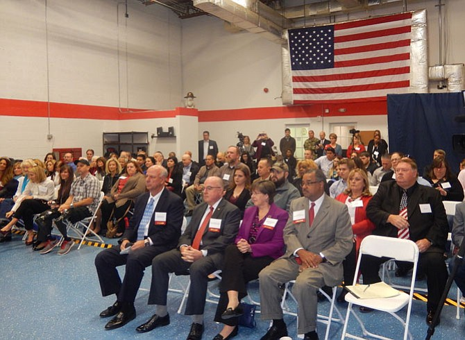 Among the crowd, in the front row, are (from left) Gerald Gordon, John Harvey Jr., Kathy Smith and Antonio Doss.