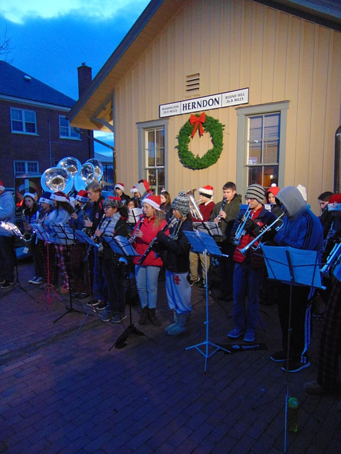 The Herndon High School Band plays Christmas Carols during the Tree-Lighting Ceremony on Saturday, Dec. 3 in front of Herndon's Old Town Hall on Elden Street.