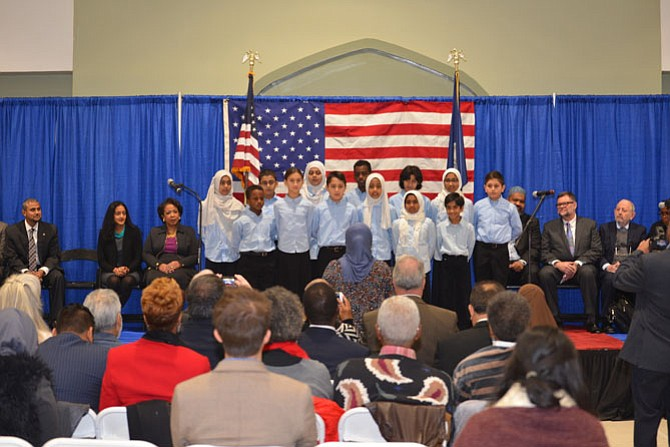 "Children from the ADAMS choir helped open and close the event, singing songs of peace to start the program, and ending with ""America the Beautiful."""