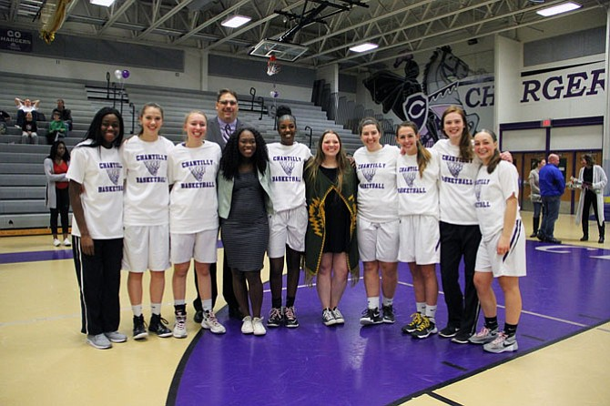 Chantilly Seniors pose for a group photo before the start of the Senior Night game against West Potomac. From left are Jahliya Sisohor, Mary Clougherty, Grace Rauch, Coach Kurt Sporkmann, Manager Jordan Long, Bilan Hajinur, Manager Kennedy Jenkins, Mary Connell, Hannah Reeves, Sarah Maxseiner, and Chiara Ballam.