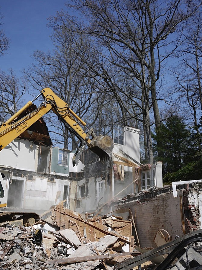 One way of tearing down a house in Arlington is to demolish it, sending tons of slate, hardwood, granite, glass, and appliances into a landfill. It takes about two days and costs about $25,000.