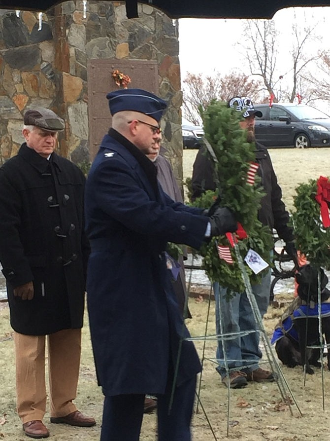 Colonel Alan Chambers, US Air Force, 779th Surgical Operations Squadron Joint Base Andrews, Fort Belvoir and Walter Reed, lays a remembrance wreath in memory of those who served and are serving in the United States Air Force during National Wreaths Across America Day held at Chestnut Grove Cemetery, Herndon, Saturday, Dec. 17.