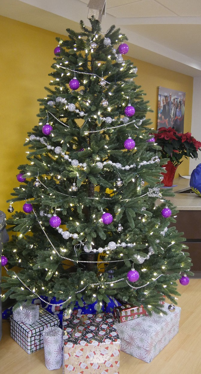 A large Christmas tree greets visitors and homeless clients at the reception area of the Homeless Services Center at 2010-A 14th Street N.