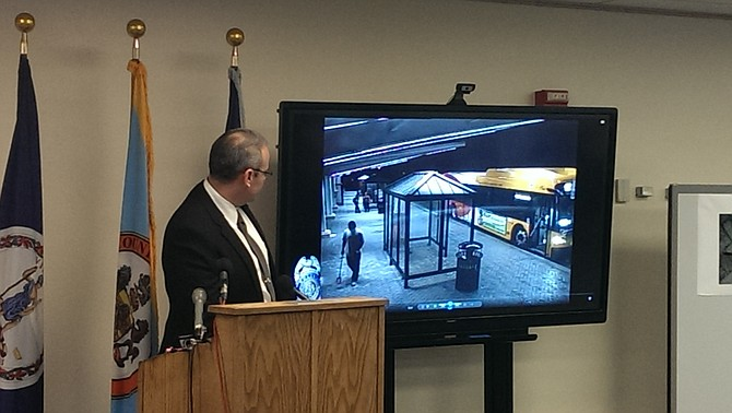 Left, David Smith, commander of Fairfax County Police Department major crimes division, breaks down the security camera footage of events leading up to and following Yovani Amaya Gomez (pictured on screen holding a sign post he used to attack a security guard and Sheriff's deputy) being shot by Master Deputy Sheriff Patrick McPartlin.