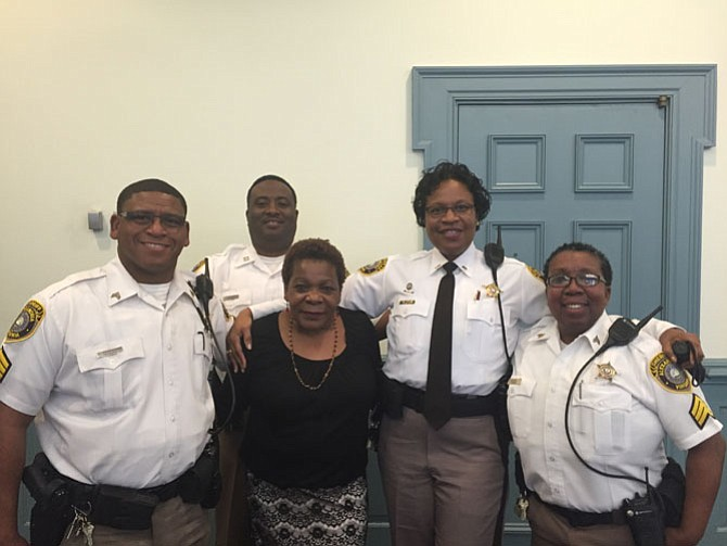 Sheriff's deputies, who are the court supervisors, congratulate Clerk of Courts Marion Jackson. From left are Sgt. Larry Richardson, Capt. Shelbert Williams, Lt. Melissa Josiah, and Sgt. Debra Hall.