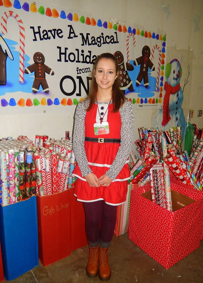Franklin Middle eighth-grader Mary Donnelly made sure each recipient family received three rolls of wrapping paper for their gifts.