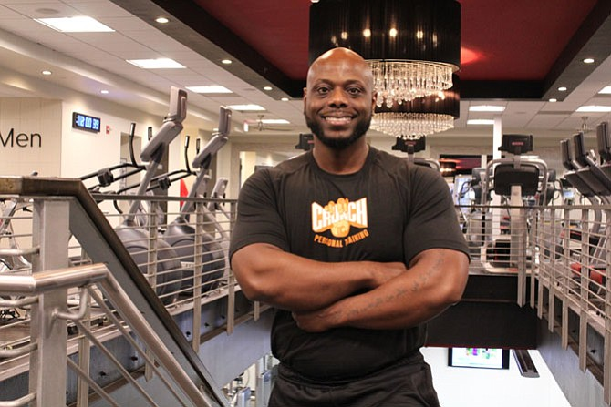Crunch Fitness Reston Town Center Fitness Director Cali Garner, who stands at 5 foot and 7 inches, made a fitness resolution in 2009 that helped him go from 255 pounds to 189 pounds.