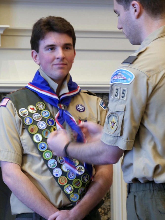 Thomas Pollack receives his Eagle Neckerchief in a ceremony Saturday Jan. 7 at the Army-Navy Country Club. He began Scouting at 6 years old.