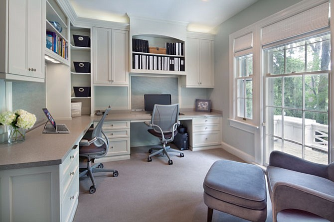 This new home office by Anthony Wilder Design/Build incorporates a custom-designed cord control system.