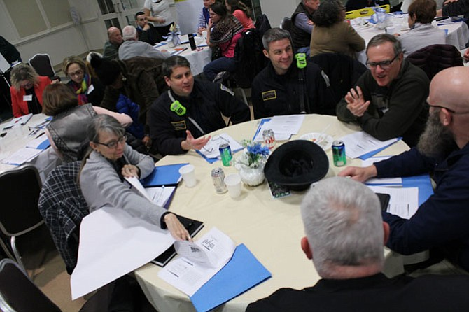 A table of first responders, representatives from area faith groups and the Reston Hospital Center discuss how their organizations could help during the recovery phase of a disaster situation.