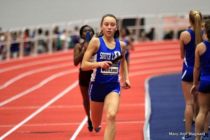Olivia Beckner in the 4x400 meter relay race.