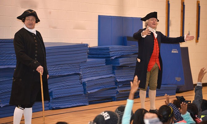 """Only minutes into the hour-long assembly at McNair Elementary School in Herndon, and """"Patrick Henry"""" (brought to life by Richard Shumann) and """"Thomas Jefferson"""" (realistically portrayed by Bill Barker) had all of the fourth and sixth graders seriously engaged. The pair of Colonial visitors have been re-enacting their characters for so many years, especially through the Colonial Williamsburg Foundation."""