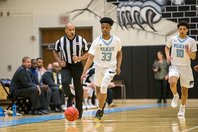Centreville's Bryce Douglas #33  dribbles the ball up the court in teams win over Westfield