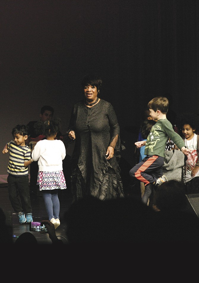 "Helen Slade of New York's Cotton Club brought the audience to its feet with songs such as ""We Shall Overcome"" at the Martin Luther King, Jr. Tribute Concert on Sunday, Jan. 15 in the Wakefield High School auditorium. In a highlight of the evening, Slade invited children from the audience to dance and sing with her on stage."