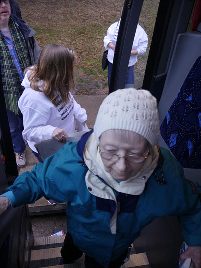 "Eighty-eight-year old Ivy South boards the bus for the Women""s March on Saturday, Jan. 21. She said it was her first march, ""But I'm ready to go again."""