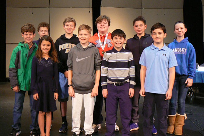 Eighth-grader and Arlington resident Chris Stewart (pictured in middle with his medal) won the school's Bee for the third consecutive year and now advances to the state level.