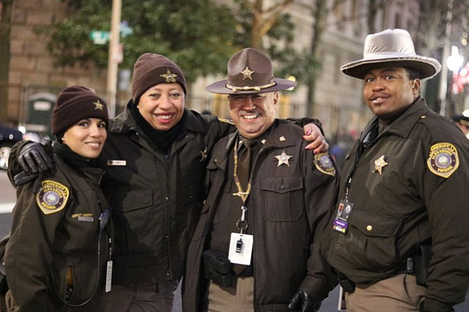 Alexandria Sheriff's Office deputies Nora Jones, Myrna Juarez, Ernesto Arroyo and Samuel Clark gather before the start of Inauguration Day activities Jan. 20. The deputies were among 13 ASO deputies sworn in to assist with security throughout the day. Photo by Patrick Cushing