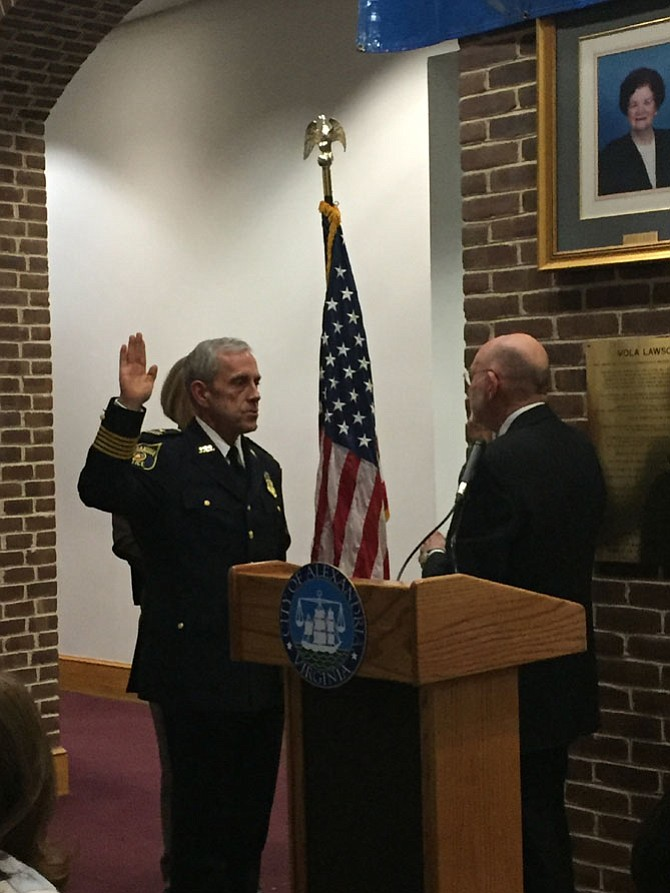 Michael Brown is sworn is as Alexandria Chief of Police Jan. 24 in the Vola Lawson Lobby of City Hall. Administering the oath to Chief Brown is Clerk of the Court Ed Semonian.