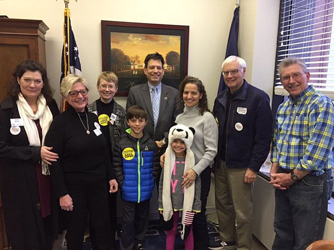 Members of the Mount Vernon Unitarian Church meet with (center) state Sen. Scott Surovell (D-36) in Richmond.