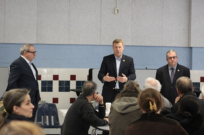 Del. Mark Sickles, Lee District Supervisor Jeff McKay and state Sen. Adam Ebbin at the Jan. 28 town hall meeting at Hayfield Elementary School.