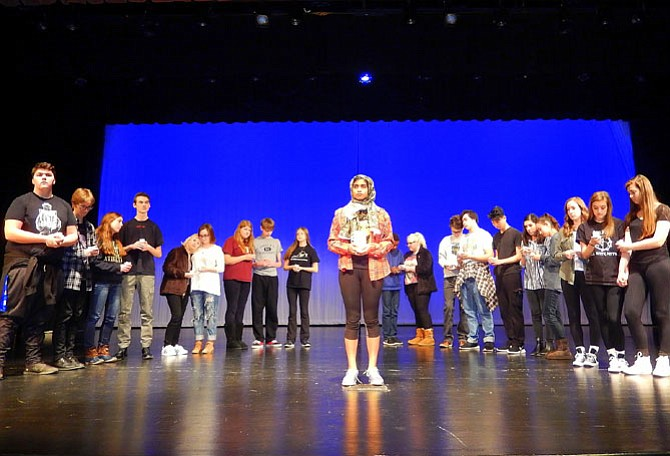 "The townspeople hold a vigil for Matthew Shepard during Westfield High's production of ""The Laramie Project."""