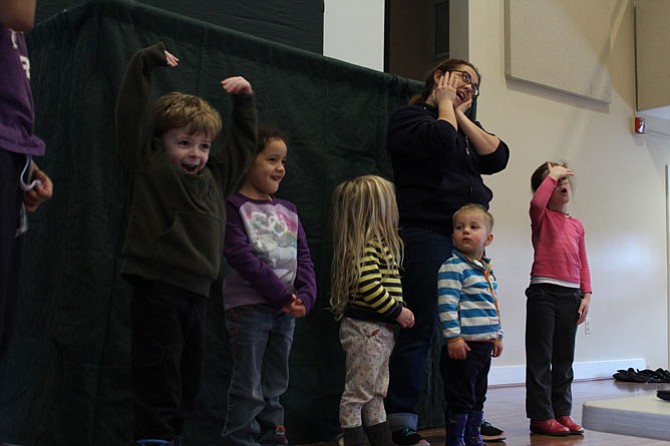 Children were invited on stage to sing and dance to Groundhog Day-themed songs, led by Fairfax County Park Authority's Clair Thompson.