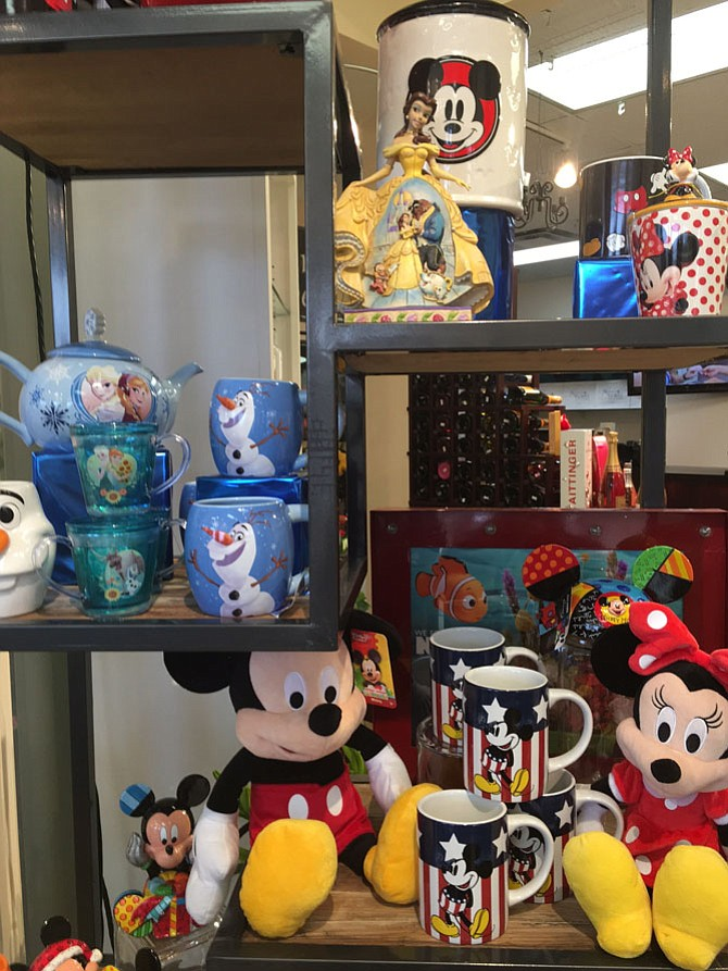 "Playful Disney accessories, from ""Frozen"" drinking cups with swirling glitter to a large Anna and Elsa teapot, call to kids at Karin's Florist. Fill the cup or teapot with ""conversational"" candies for the kids in your lives. Cup sells for $7.99."