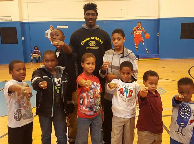 "Members of the flag football winning ""Miami Dolphins"" team of the Dunbar Alexandria-Olympic Boys and Girls Club show off their Super Bowl rings at a recent assembly. A fundraiser for the club will be held Feb. 10 at the Carlyle Club."