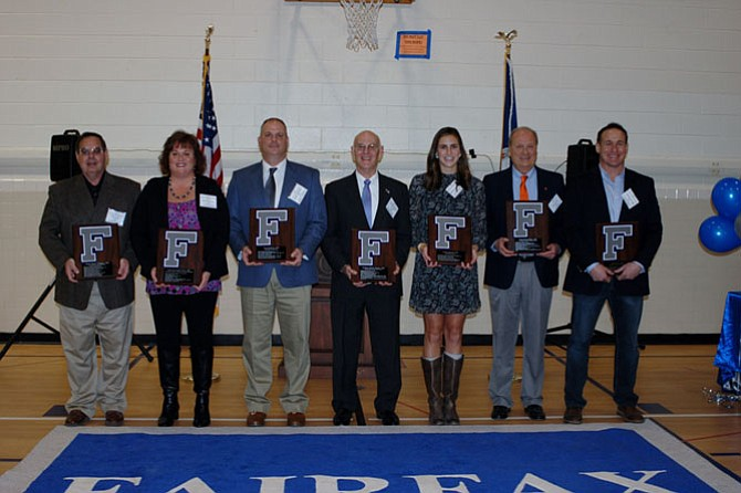 """FHS 2017 Hall of Fame inductions held Jan. 13, 2017. From left: Davey Williams, Class of 1968, Football/Wrestling, Kathy McCaughey-Eker, Class of 1980, Softball/Tennis/Track, David Bedwell, Class of 1989, Football, Richard """"Moon"""" Ducote, Class of 1968, Football/Wrestling, Emily Ferguson, Class of 2008, Swimming, Craig White, Class of 1968, Football/Baseball, Justin Potter, Class of 1998, Wrestling/Football."""