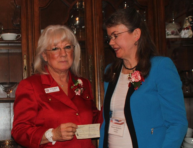 On behalf of the Republican Women of Clifton, President Bonnie Burkhardt (right) presents a $500 check to Susan Wight in support of the Tragedy Assistance Program for Survivors.