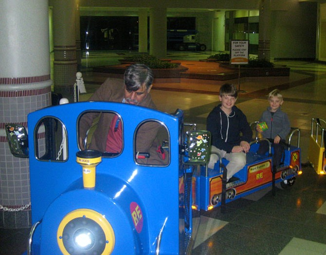 Tariq Kahn drives the train at Landmark Mall, carrying  Sawyer and Max McElhatton. The photo was taken one day before Khan must leave the mall on Jan. 30.